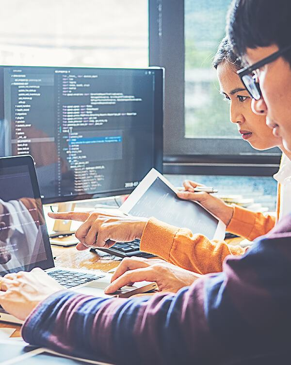 Man and woman coding together